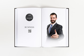 businessman making a deal printed on book