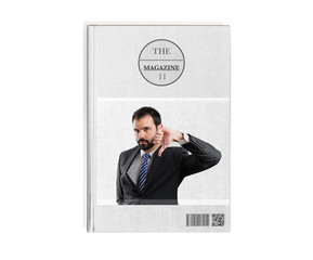 Young businessman with his thumb down printed on book