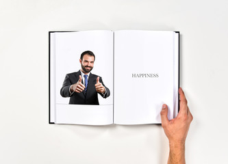 Young businessman getting OK  printed on book