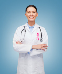 doctor with stethoscope, cancer awareness ribbon