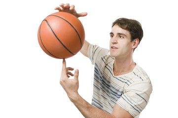 man on white hold the basket ball