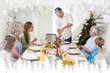 Composite image of father serving christmas meal to family
