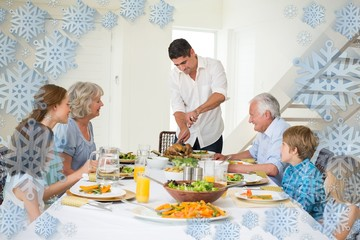 Composite image of father serving meal to family
