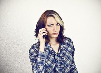 Angry girl at smart phone