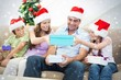 Composite image of family exchanging christmas gifts