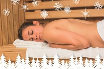 Calm brunette lying down in a sauna