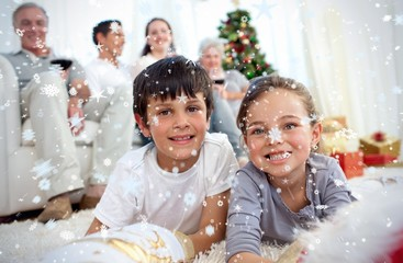 Smiling children looking for presents in christmas