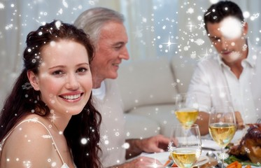 Woman celebrating christmas dinner with her family