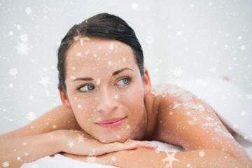 Peaceful brunette lying with salt scrub on back