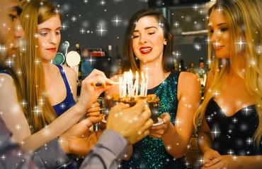 Composite image of happy friends preparing birthday cake