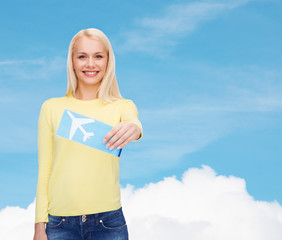 smiling young woman with airplane ticket
