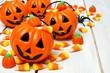 Group of Halloween Jack o Lantern candy holders on wood