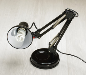 Black adjustable desk lamp on the bright background