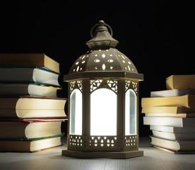 Lantern between many books
