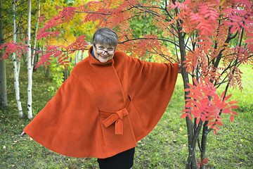 Happy Mature woman in autumn Park . Autumn age.