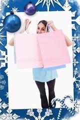 Portrait of a joyful woman showing shopping bags