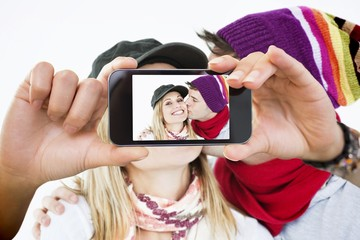 Composite image of hand holding smartphone showing