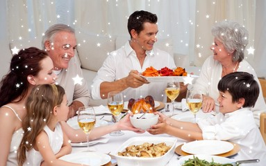 Composite image of family having a big dinner at home