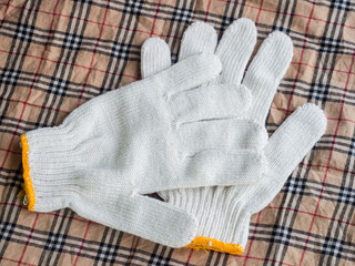 pair of butlers white gloves isolated on fabric with clipping pa