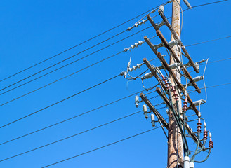 Electricity wood utility pole lines,clear blue sky background