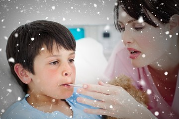 Composite image of caring nurse taking her patients temperature