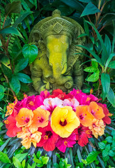 Ganesh stone statue with hibiscus flowers, Thailand