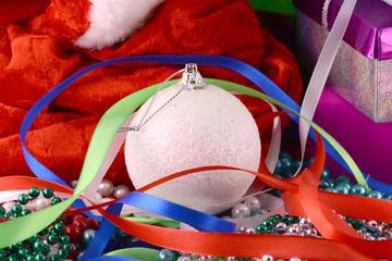 Christmas background with gift box, diamonds, new year balls