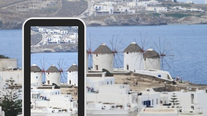 Tablet, smartphone taking picture of Greek island