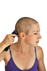 Woman in purple bodice shaving herself bald with clipper