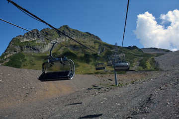 Empty chairlifts moving in the mountains