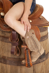 cowgirl on saddle on barrel
