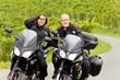 canvas print picture - Zweiradfahrer mit Blick in die Kamera auf ihren Motorrädern