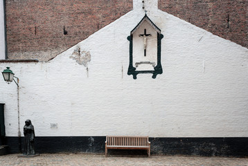 Bench and crucifix in the Beguinage  Belgium