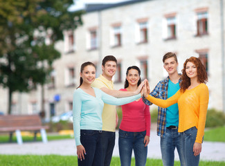 group of smiling teenagers over campus background