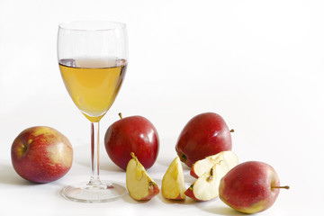 apple juice and red apples, white background