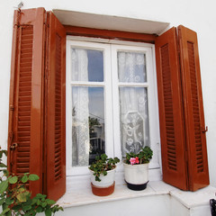 Athens Greece, vintage house window and flower pots