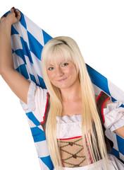 hübsche Frau im Dirndl mit Bayern Flagge