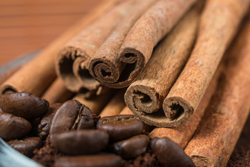 Close up of  cinnamon and coffee heap.