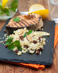 fish grill with cous cous, almonds, raisins and mint