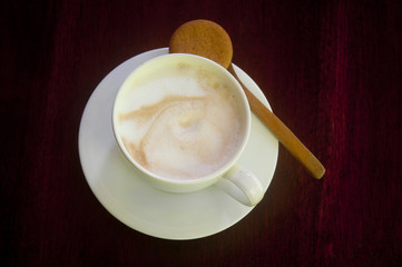 A Cappuccino on a Wooden Table