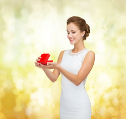 smiling woman holding red gift box