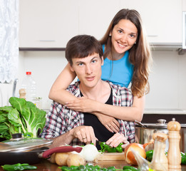 Happy man and  woman cooking food