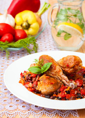chicken stewed in tomato sauce with beans and vegetables