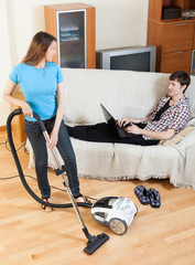 Woman cleaningwith vaccuumcleaner