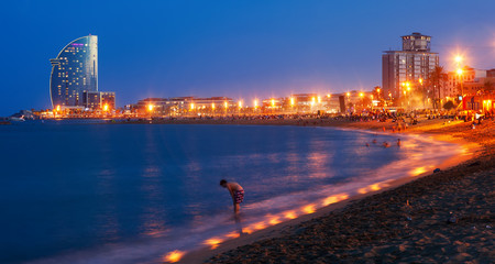 Beach in summer evening in Barcelona, Spain