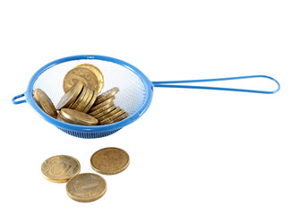 Concept of money laundering - coins in strainer