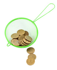 Idea of money laundering - coins in strainer