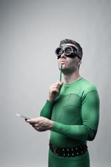Superhero thinking with green pencil