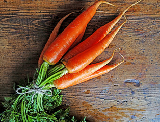 bundle of carrots on wooden background