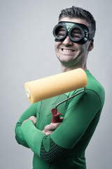 Funny superhero with painting roller